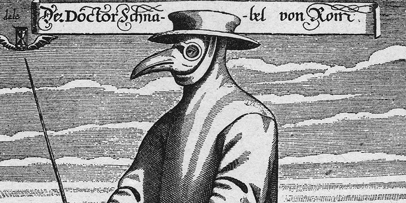 """Un """"medico"""" con la classica maschera a forma di becco, nel quale erano inserite spezie che si pensava purificassero l'aria evitando i contagi da peste, in una stampa di metà Seicento (Hulton Archive/Getty Images)"""